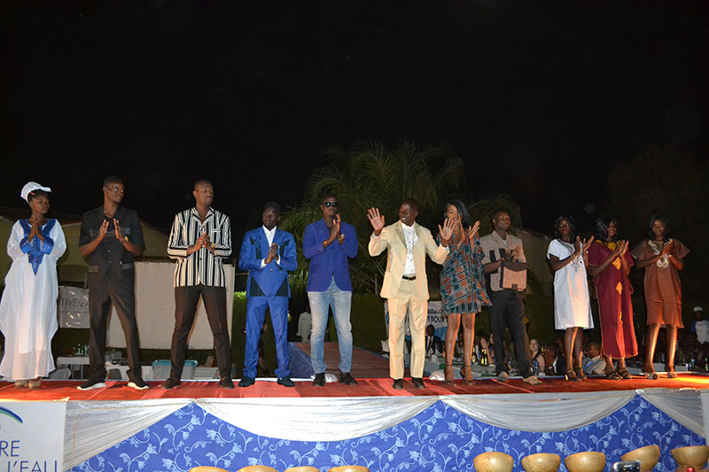 Designer Koadima Boukari (in tan suit) organized the fashion show