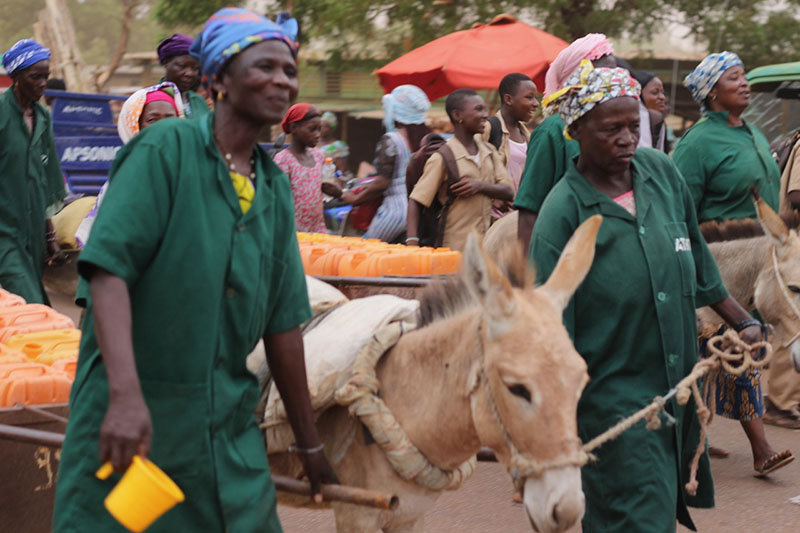 Women who carry water in donkey carts